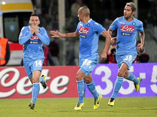 Napoli's Dries Mertens celebrates with teammates after scoring his team's second goal against Fiorentina on October 30, 2013