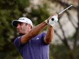 Dustin Johnson of the US tees off at the 12th hole before finishing in the lead on day two of the WGC-HSBC Champions tournament at the Shanghai Sheshan International Golf Club on November 1, 2013