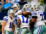 Wide receiver Dwayne Harris of the Dallas Cowboys is congratulated by teammates after scoring a touchdown late in the 4th quarter during the game against the Minnesota Vikings on November 3, 2013