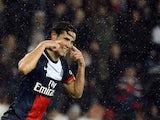 PSG's Edinson Cavani celebrates after scoring his team's third goal against Lorient on November 1, 2013