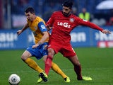 Leverkusen's Emre Can and Braunschweig's Norman Theuerkauf battle for the ball on