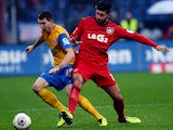 Leverkusen's Emre Can and Braunschweig's Norman Theuerkauf battle for the ball on