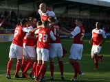 Fleetwood players celebrate after scoring the first goal from the penalty spot during the Sky Bet League two match between Fleetwood Town and Newport County at Highbury Stadium on November 02, 2013