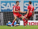 Bayern's Thomas Mueller celebrates with teammate Franck Ribery after scoring the his team's second goal against Hoffenheim on November 2, 2013