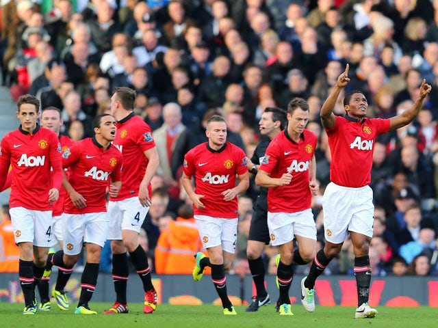 Luis Antonio Valencia of Manchester United celebrates scoring the first goal during the Barclays Premier League match between Fulham and Manchester United at Craven Cottage on November 2, 2013