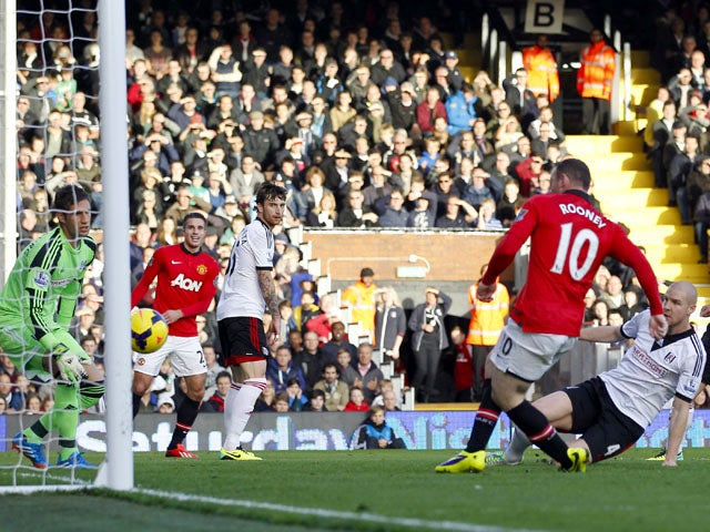 Manchester United's English striker Wayne Rooney scores the opening goal during the English Premier League football match between Fulham and Manchester United at Craven Cottage in London on November 2, 2013
