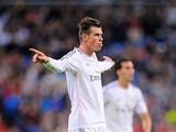 Real's Gareth Bale celebrates after scoring his team's second goal against Sevilla on October 30, 2013
