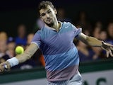 Grigor Dimitrov returns a shot to Argentina's Juan Martin Del Portro during their third round match at the ninth and final ATP World Tour Masters 1000 indoor tennis tournament on October 31, 2013