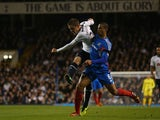 Tottenham's Gylfi Sigurdsson beats Hull's Curtis Davies to score the opening goal in their Capital One Cup Fourth Round match on October 30, 2013