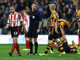 Lee Cattermole of Sunderland is sent off with a red card by referee Andre Marriner after a foul on Ahmed Elmohamady (down) of Hull during the Barclays Premier League match between Hull City and Sunderland at KC Stadium on November 2, 2013