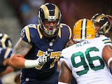 Jake Long #77 of the St. Louis Rams blocks during a preseason game against the Green Bay Packers at the Edward Jones Dome on August 17, 2013