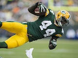 James Starks of the Green Bay Packers sails through the air on a tackle by the Washington Redskins at Lambeau Field on September 15, 2013