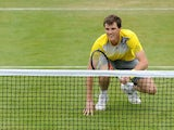 Jamie Murray of Great Britain reacts during the Men's Doubles first round match with John Peers of Australia against Grigor Dimitrov of Bulgaria and Frederick Nielsen of Denmark on day three of the AEGON Championships at Queens Club on June 12, 2013