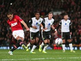 Javier Hernandez of Manchester United scores from the penalty spot during the Capital One Cup fourth round match between against Norwich City on October 29, 2013