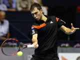 Polish tennis player Jerzy Janowicz returns a ball to Spanish tennis player David Ferrer during the Open 500 Valencia quarter-finals match at the Agora space in Valencia, on October 25, 2013