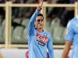 Napoli's Jose Maria Callejon celebrates after scoring the opening goal against Fiorentina on October 30, 2013