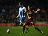 Keith Andrews of Brighton and Hove Albioin battles with Josh McEachran of Watford during the Sky Bet Championship match on October 28, 2013