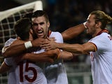 AS Roma's Kevin Strootman celebrates after scoring a goal with Miralem Pjanic and Federico Balzaretti against Torino on November 3, 2013