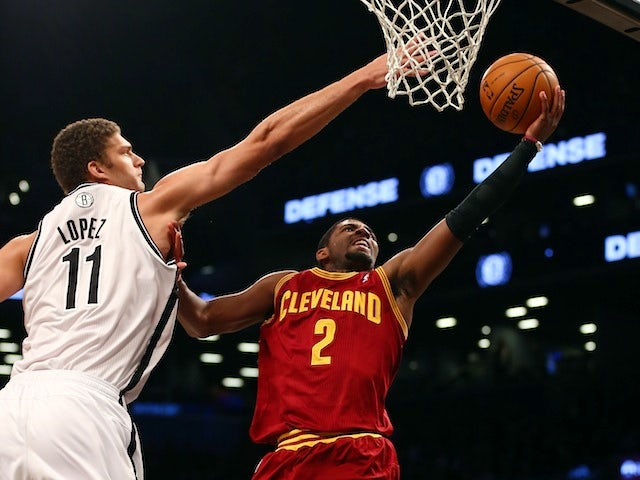 Cleveland Cavaliers guard Kyrie Irving looks to make a shot under pressure from Brooklyn Nets center Brook Lopez on November 13, 2012