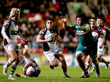 Ben Botica of Harlequins runs under pressure from Logovii Mulipola of Leicester Tigers during the Aviva Premiership match between Leicester Tigers and Harlequins at Welford Road on November 2, 2013