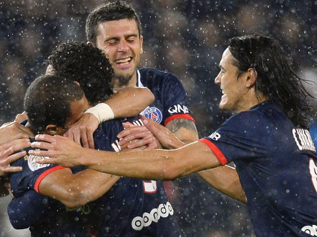 PSG's Lucas Moura is congratulated by teammates after scoring the opening goal against Lorient on November 1, 2013