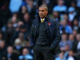 Norwich Manager Chris Hughton looks on during the Barclays Premier League match between Manchester City and Norwich City at Etihad Stadium on November 2, 2013