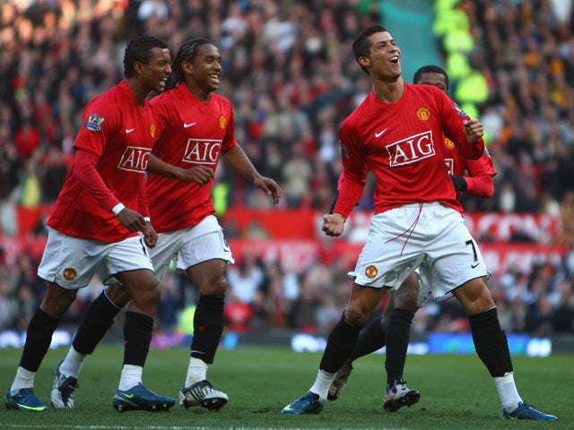 Cristiano Ronaldo of Manchester United celebrates scoring the opening goal with his team mates during the Barclays Premier League match between Manchester United and Hull City at Old Trafford on November 1, 2008