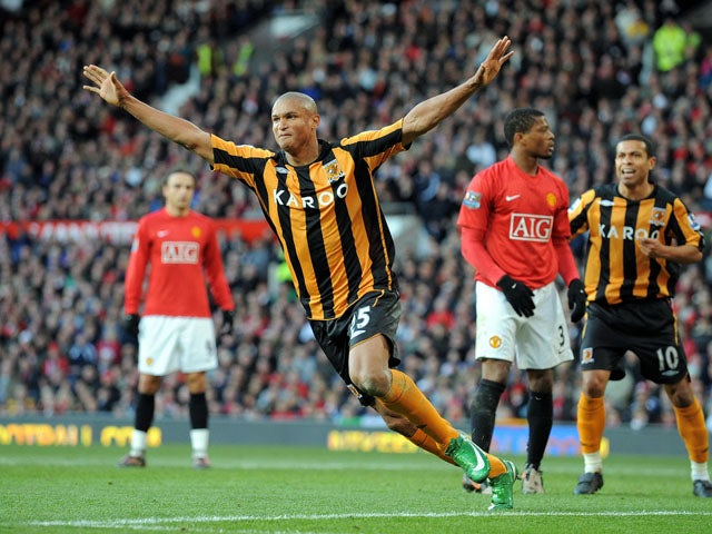 Hull City's French-Gabonese forward Daniel Cousin celebrates after scoring during the English Premier league football match against Manchester United at Old Trafford, Manchester , north-west England, on November 1 2008
