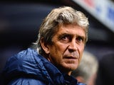Man City manager Manuel Pellegrini prior to kick-off against Newcastle in their Capital One Cup Fourth Round match on October 30, 2013