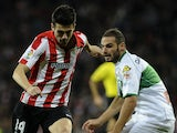 Athletic Bilbao's midfielder Markel Susaeta vies with Elche's defender Lomban during the Spanish league football match on October 31, 2013