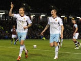 Matt Taylor of West Ham celebrates scoring the opening goal from the penalty spot during the Capital One Cup Fourth Round match against Burnley on October 29, 2013