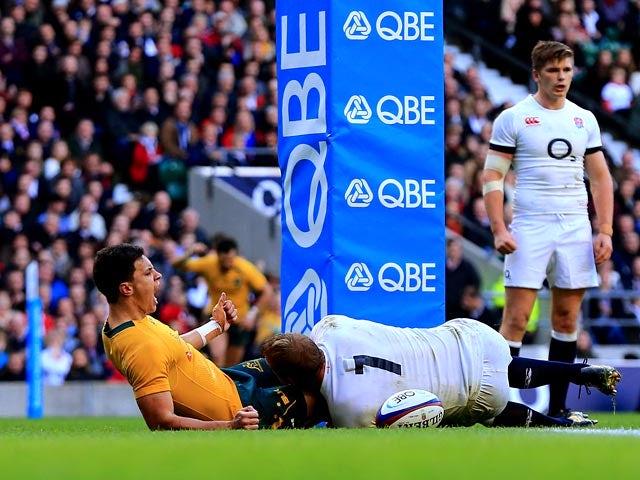 Australia's Matt Toomua celebrates after scoring the opening try against England on November 2, 2013