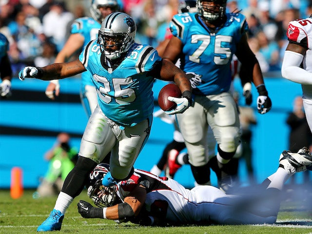 Mike Tolbert of the Carolina Panthers runs with the ball against the Atlanta Falcons during their game at Bank of America Stadium on November 3, 2013