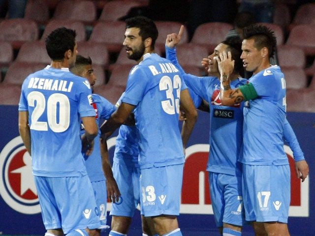 Napoli's Spanish forward Jose Maria Callejon celebrates with teammates after scoring during the Italian Serie A football match SSC Napoli vs Calcio Catania in San Paolo Stadium on November 2, 2013