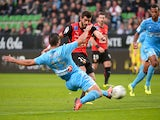 Rennes' Nelson Oliveira scores the opening goal against Marseille on November 2, 2013