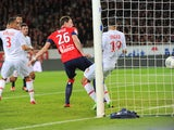 Lille's French forward Nolan Roux scores during their French L1 football match Lille vs Monaco on November 3, 2013