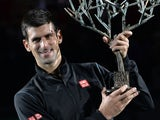 Serbia's Novak Djokovic poses with his trophy after winning the final match of the ninth and final ATP World Tour Masters 1000 indoor tennis tournament on November 3, 2013
