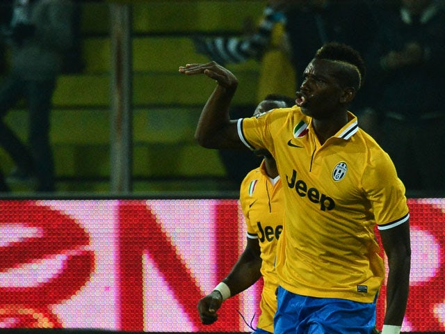 Juventus' French midfielder Paul Pogba celebrates after scoring during the Serie A football match Parma vs Juventus at 'Tardini Stadium' in Parma on November 2, 2013