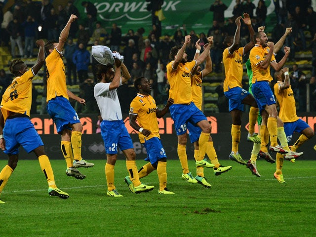 Juventus team's players celebrate at the end of their Serie A football match Parma vs Juventus at 'Tardini Stadium' in Parma on November 2, 2013