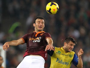 Vasilis Torosidis of AS Roma competes for the ball with Perparim Hetemaj of AC Chievo Verona during the Serie A match on October 31, 2013
