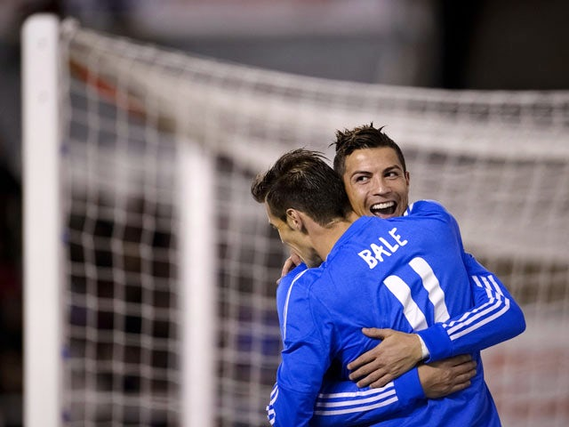 Real Madrid's Portuguese forward Cristiano Ronaldo celebrates with Real Madrid's Welsh striker Gareth Bale after scoring during the Spanish league football match Rayo Vallecano vs Real Madrid at the Vallecas stadium in Madrid on November 2, 2013
