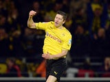 Dortmund's Robert Lewandowski celebrates after scoring his team's third goal against Stuttgart on November 1, 2013