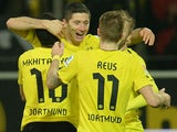 Dortmund's Robert Lewandowski celebrates with teammates after scoring his team's fourth goal against Stuttgart on November 1, 2013