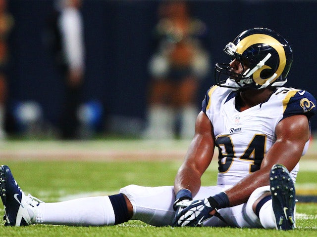 Robert Quinn of the St. Louis Rams reacts to a touchdown by Frank Gore of the San Francisco 49ers in the second quarter at Edward Jones Dome on September 26, 2013