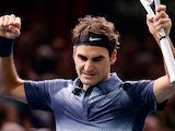 Roger Federer celebrates his win over Juan Martin Del Potro during the quarter finals of the Paris Masters on November 1, 2013