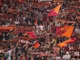 AS Roma fans support their team during the Serie A match between AS Roma and Bologna FC at the Stadio Olimpico on September 29, 2013