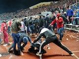 Russian football fans clash during the Russia's premier league football match Shinnik Yroslavl vs Spartak Moscow in Yaroslavl on October 30, 2013