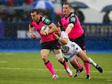 Sam Warburton of Cardiff is held by Frederic Michalak during the Heineken Cup pool 2 match between Cardiff Blues and Toulon at Cardiff Arms Park on October 19, 2013