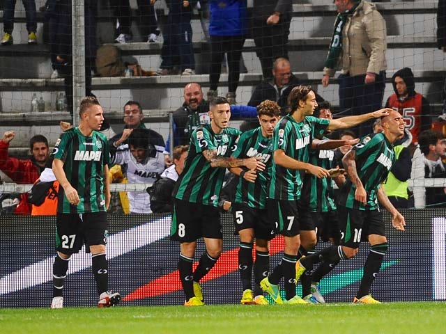 US Sassuolo Calcio's Simone Zaza is congratulated by teammates after scoring the equaliser against Udinese on October 30, 2013
