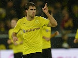 Dortmund's Sokratis celebrates after scoring the equaliser against Stuttgart on November 1, 2013